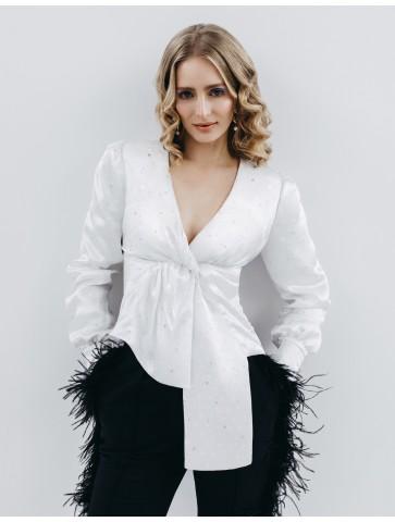 A silk blouse with an...